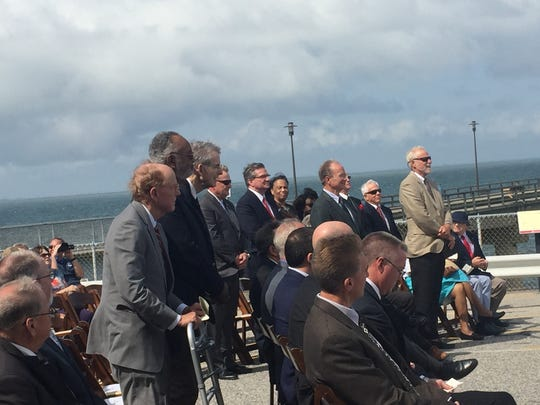 Members of the Chesapeake Bay Bridge-Tunnel Commission stand to be recognized during a groundbreaking ceremony for the parallel tunnel project on the Chesapeake Bay Bridge-Tunnel on Monday, Sept. 18, 2017.