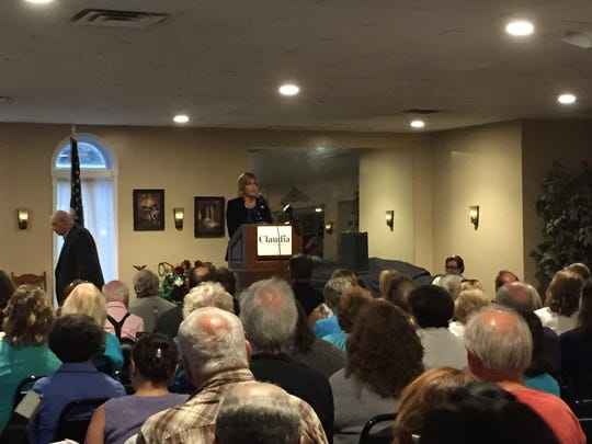 Republican Rep. Claudia Tenney answers questions at an event in Camden, New York.