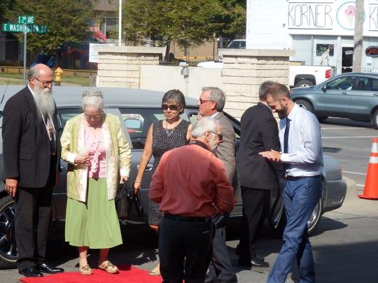 Michael Zahs and Julie Zahs, left, exit a limousine