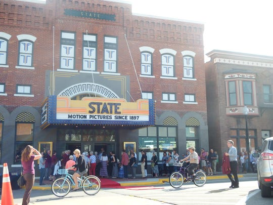 Audiences enter the Fridley State Theatre for the Iowa