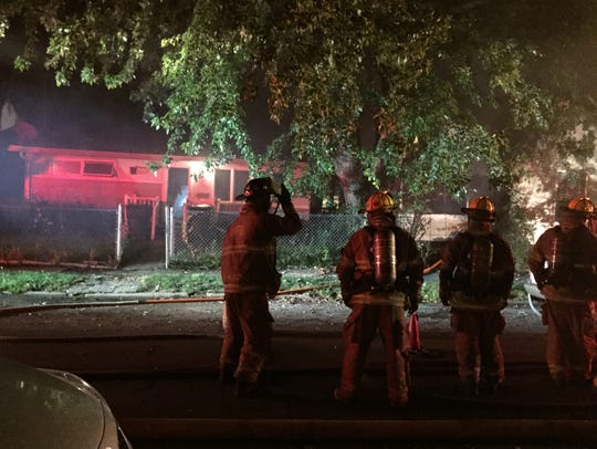 Muncie firefighters battle a house fire reported about