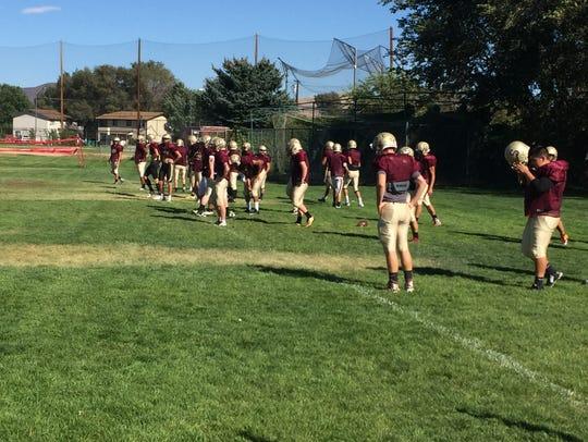 The Sparks High football team practices Tuesday.