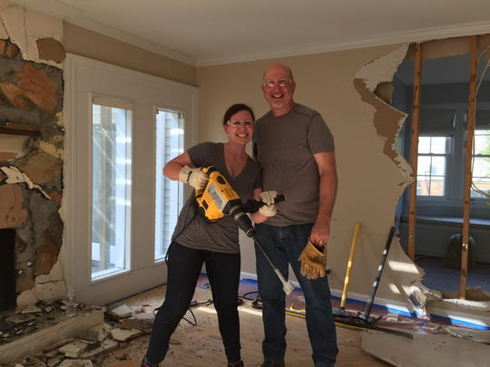 Maureen Beaver and her dad David Casto help tear out