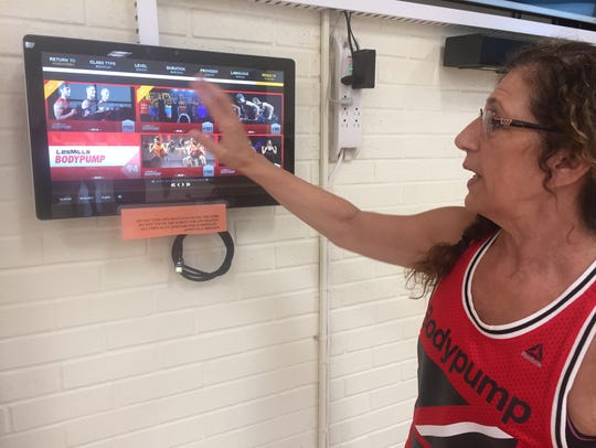 The YMCA's Annette Garrison shows how the virtual class