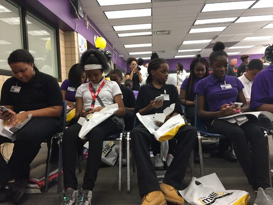 Communication and Media Arts freshmen practice on the new phones they received from Sprint.