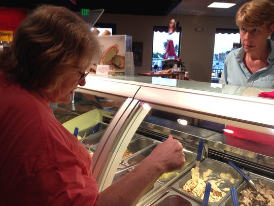 Carol Tichy orders a homemade gelato from an employee
