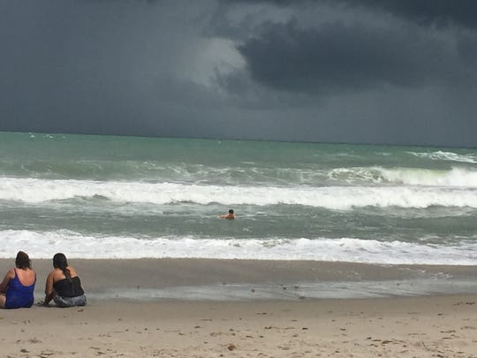 Rough surf begins to move in to Indialantic on Saturday.