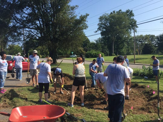 Volunteers are digging a flat patch so they can plant