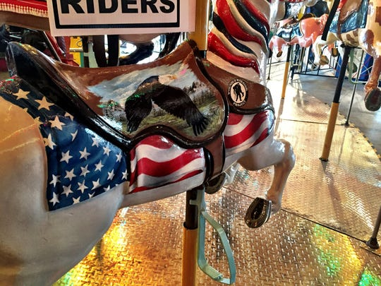 Inmates painted this horse in honor of the military. It's going to stay riderless.