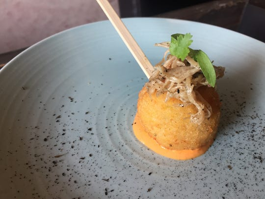 "Chef Steven Oakley of Oakley's Bistro stuffs the Italian rice balls named ""arancini"" with housemade pimento cheese and duck confit. It was one of the bites at the 2017 IndyStar Wine & Food Experience at Clay Terrace in Carmel."