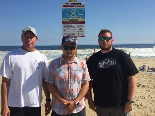 Belmar Water Rescue Team members, from left, Buzz Ciprut, Mark Spangnuolo and Brian Allen on the beach Monday, Sept. 25, 2017