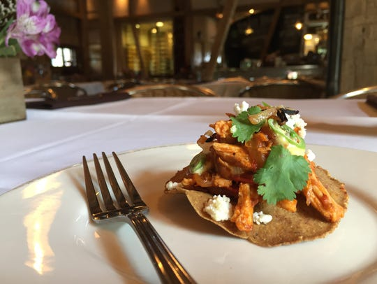 Rabbit tinga, a Mexican stew, spooned over huitlacoche
