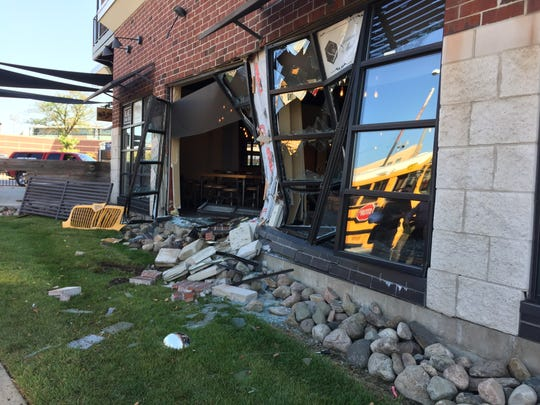 Here's a look at damaged caused to downtown Lansing's Stadium District building on Michigan Avenue. It was caused by a school bus involved Tuesday in a crash at an intersection.