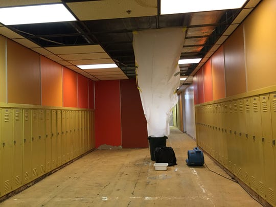 Carpets have been removed and leaks have been siphoned into garbage cans while crews finish replacing the Heart Butte School roof.