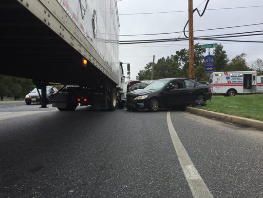 Two cars await removal Wednesday morning after an accident