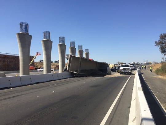 A tractor-trailer overturned on Highway 99 near Betty
