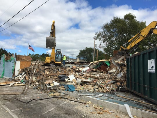 Demolition of the historic building Shipwrecked Brewpub was completed Wednesday. Crews are clearing the site for the company to build a new microbrewery and restaurant.