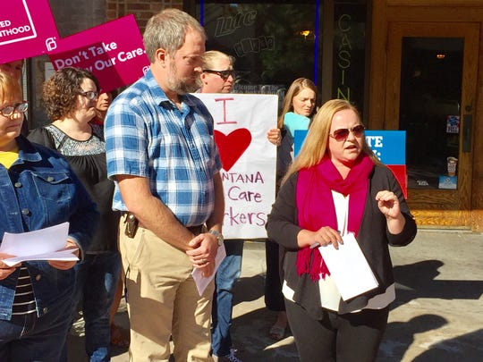 Laura Terrill of Planned Parenthood Advocates of Montana, right, criticizes the first 100 days of Rep. Greg Gianforte's congressional votes on Friday as Neal Ullman of Montana Conservation Voters looks on.