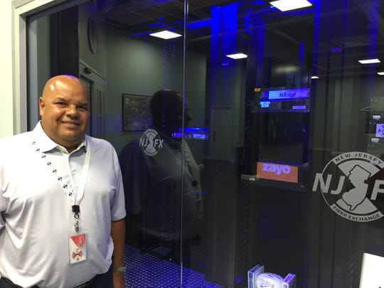 Gil Santaliz, chief executive officer of New Jersey Fiber Exchange in Wall, wants to turn the town into a hub for data companies.