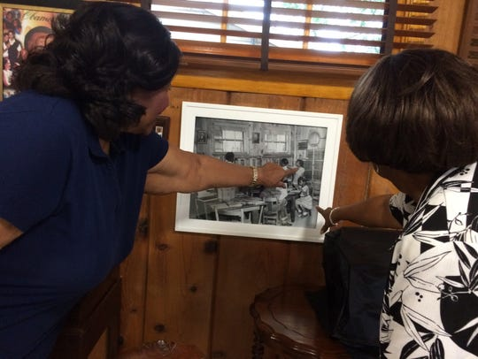 Clara Freeze and Sandra Gray check out a photograph