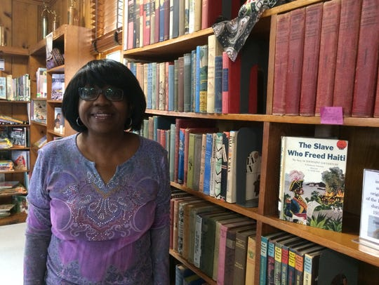 Erma Brooks, a VISTA volunteer from ASU, is the librarian
