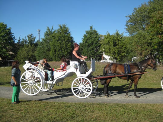Horse and buggy rides, sponsored by Gloria Zastko Realtors,