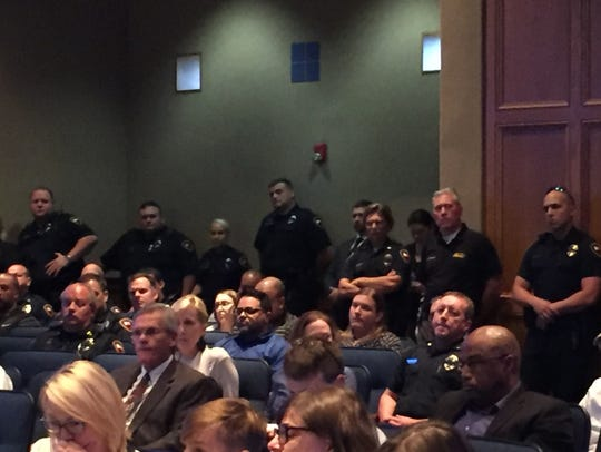Lafayette Police officers gathered Tuesday at the City-Parish