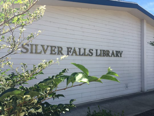Silver Falls Library Board member Kathy Beutler visited