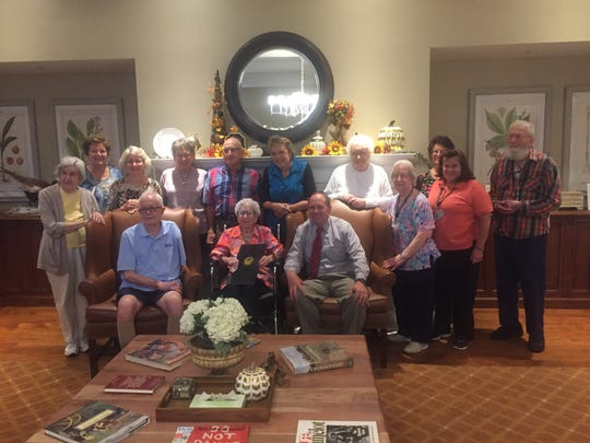 Friends and fellow residents gather with Clara Hermman and Sen. Jay Hottinger at Middleton.