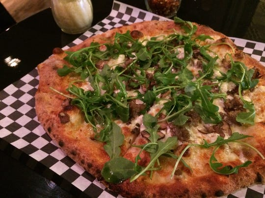 The Fun Guy (topped with portabella mushrooms, house blend cheese, goat cheese on top of a white sauce and finished with arugula drizzled with white truffle oil) is the best seller at Broken Tree Pizza in Neenah.