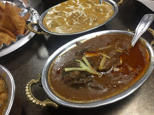 Mutton nihari, a spicy mutton stew, and malai kofta, potato balls in creamy gravy,  at Bombay Bazaar in Fishers.