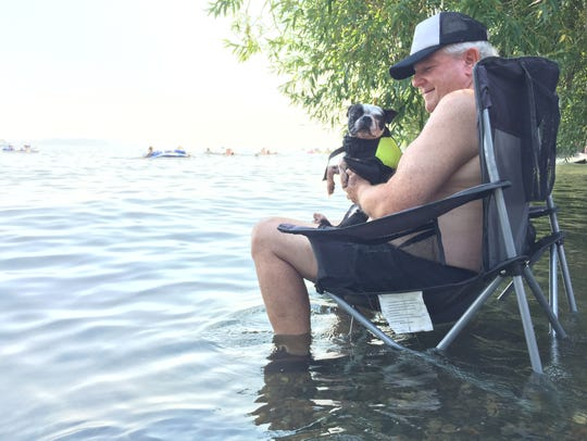 Gary Waldron and his family's dog cool themselves in