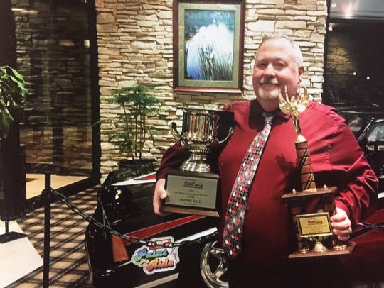 Dennis Hall poses with the Bill Bader Sportsman of