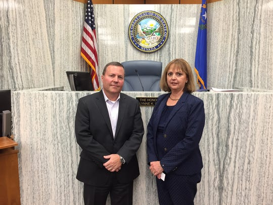 Judges Barry Breslow and Lynne Simons pose for a photo on Oct. 11, 2017 at Simon's courtroom at the Washoe County District Court.