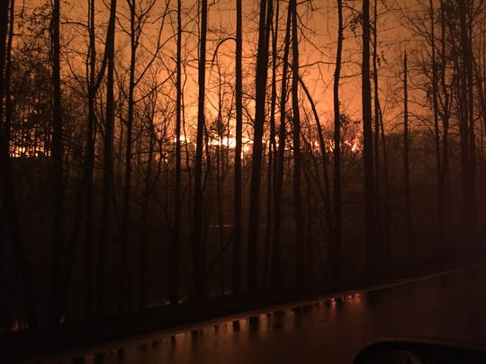 Fire was all about as crews worked to keep the Spur open on the night of the Nov. 28, 2016, Gatlinburg wildfire.