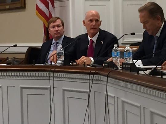 WASHINGTON -- Florida Gov. Rick Scott (center) listens Wednesday as congressional lawmakers discuss the state's response to and recovery from Hurricane Irma last month. Also pictured are Adam Putnam, state agriculture commissioner, and ,on right, Rep. Vern Buchanan.