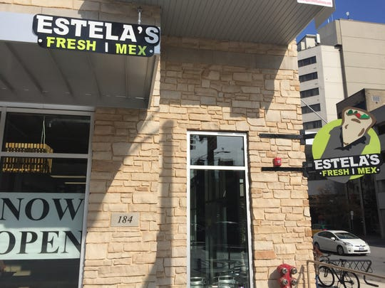 The signage for Estela's Fresh Mex is shown in Iowa City on Oct. 13, 2017.