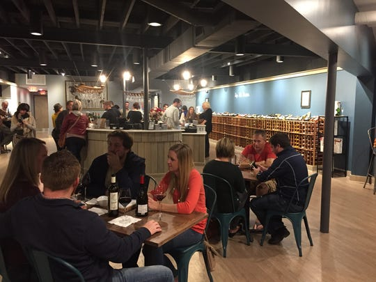 Tables and a stand-up bar furnish The Wine Market,