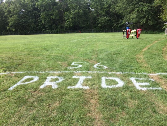 Wes-Del's practice field spray-painted with No. 56
