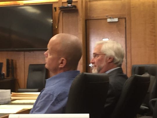 Larry Evans Jr., left, sits with public defender Gregory Meyers in October in Richland County Common Pleas Court.