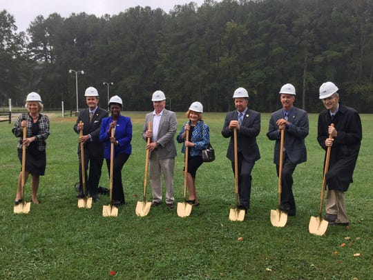 Officials ceremonially break ground for a new academic