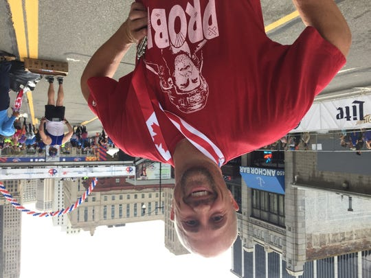 """Jared Lehne, 43, of East Greenwich, R.I. wore a red and white Bob Probert """"Probie"""" t-shirt while running the 40th Detroit Free Press/Chemical Bank Marathon."""