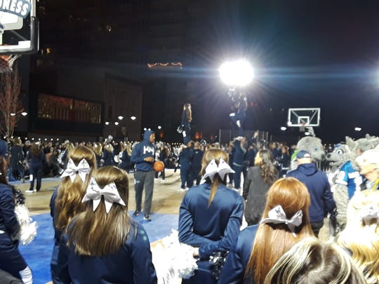 The Wolf Pack players entertain the crown at Arch Madness on Saturday in downtown Reno.