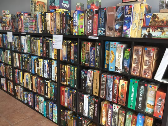 Hundreds of board games fill the shelves Monday Oct.