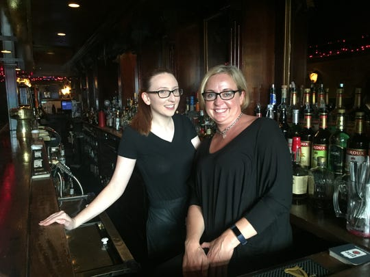 Waitress Nicole Hogan, left, and bartender Deirdre