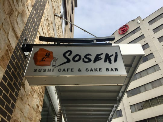 Signage for Soseki Sushi Cafe and Sake Bar at 227 S.