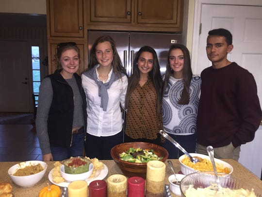"Elizabeth Benson (second from left) with her guests at her first ""Friendsgiving"": Dyanne Maas Elizabeth Benson Hailey Imbasciani Cassie Caporusso Enrique Perez"