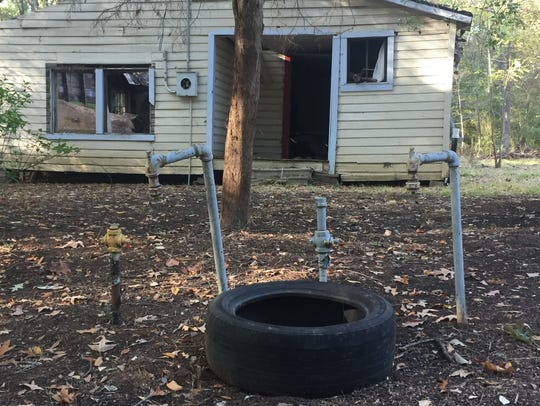 An illegally dumped tire, one of hundreds, near an