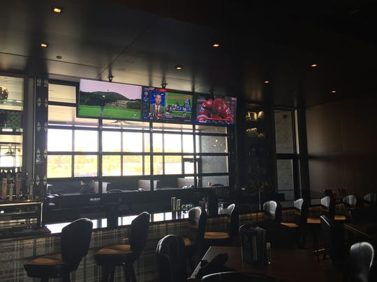 The primary bar area at Range Grill + Golf in Urbandale. The back windows open up to an outdoor portion of the bar in season.