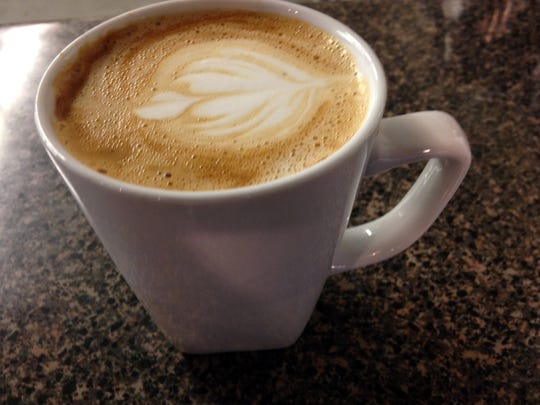 A steaming cup of cafe-latte prepared by the Life House staff.